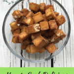 Tired of that squishy tofu texture? Learn how to cook crispy, oil-free tofu with this healthy vegan recipe. It is easy to make and baked in the oven! It is the perfect add-in for a healthy, simple dinner or lunch bowl. Repin and check out the recipe on my blog, breesveganlife.com. #breesveganlife #crispytofu #veganrecipes #oilfreetofu #glutenfree