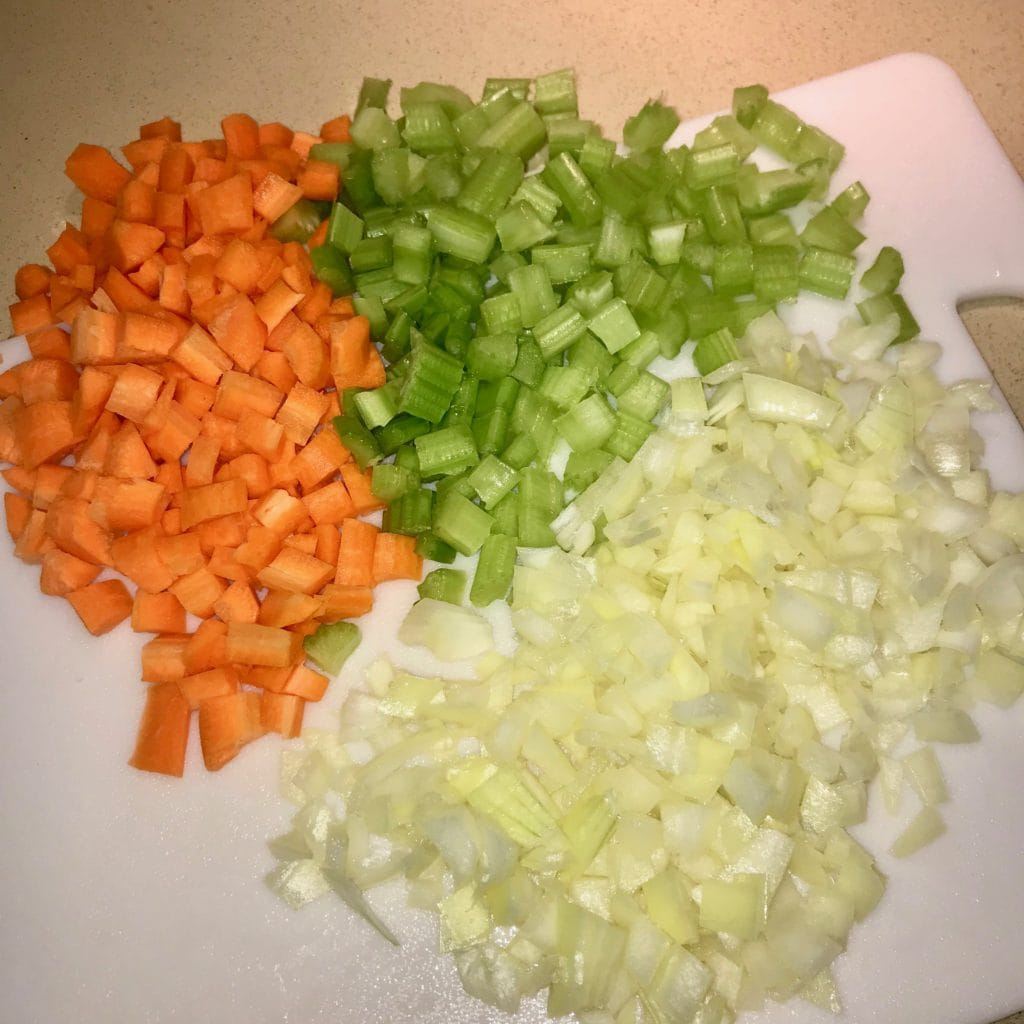 Ingredients for lentil stew (carrot, celery, and onion).