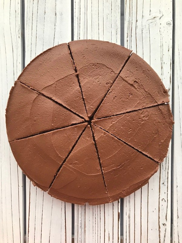 Overhead view of chocolate pie cut into 8 slices.