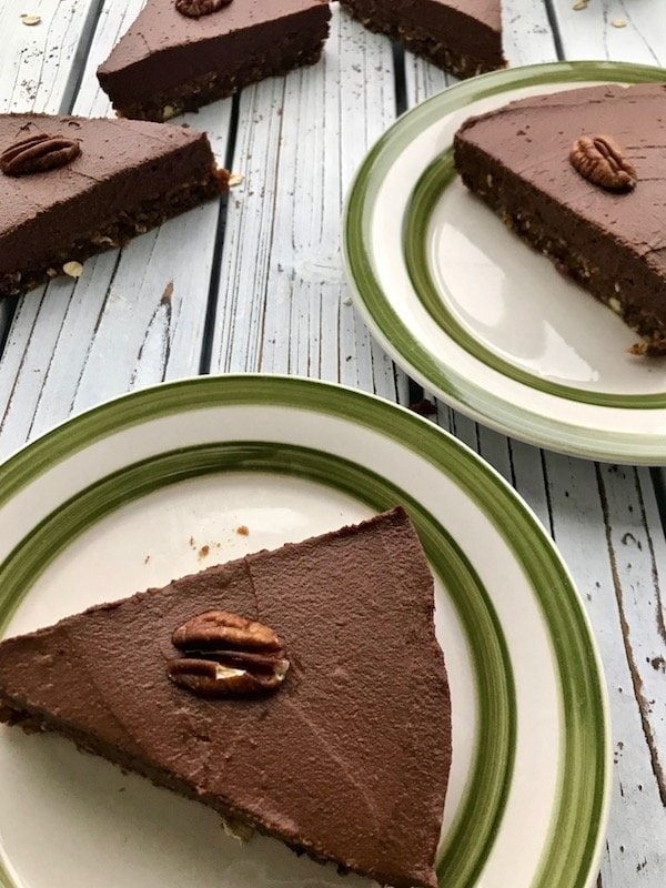 Slices of chocolate pie on plates.