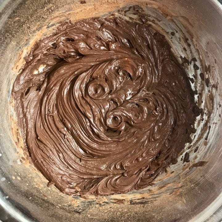 Vegan chocolate frosting in a bowl after being whipped.