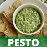 Vegan pesto is a small bowl next to baked tortilla chips with text that says Pesto.