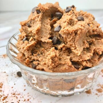 Chocolate chickpea cookie dough in a glass bowl.