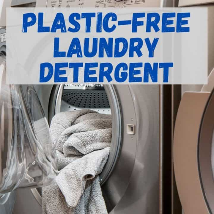 """A washing machine with a towel in it, with text that says, """"Plastic-Free Laundry Detergent."""""""