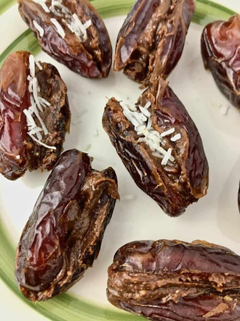 Medjool dates stuffed with chocolate peanut butter and coconut flakes.