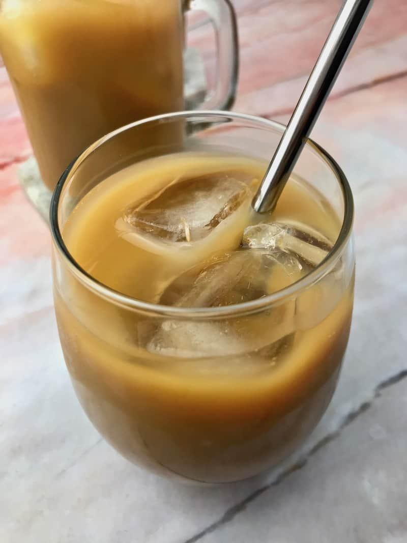 A stemless wine glass full of iced coffee.