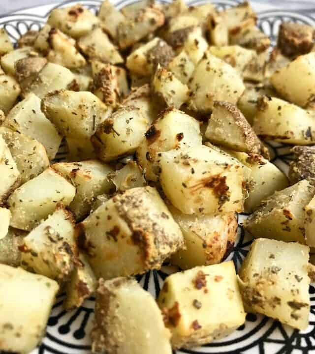 Diced roasted potatoes on a plate.