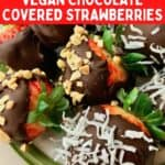 Chocolate dipped strawberries with chopped peanuts and coconut flakes on top.