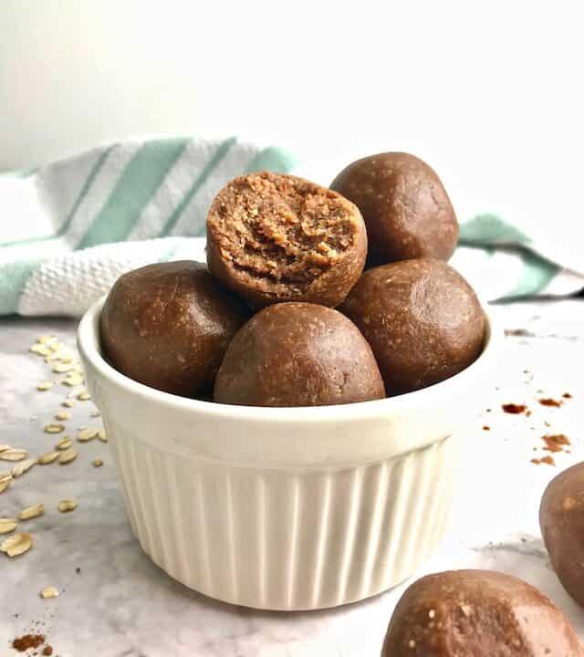 Chocolate peanut butter cookie dough balls in a ramekin.