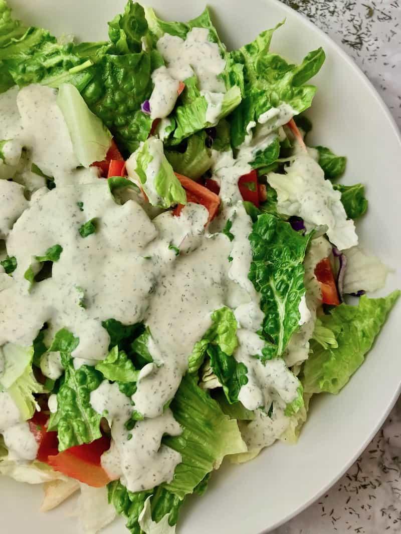 Creamy dill dressing on a green salad.