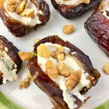Medjool dates stuffed with vegan cream cheese and chopped walnuts.