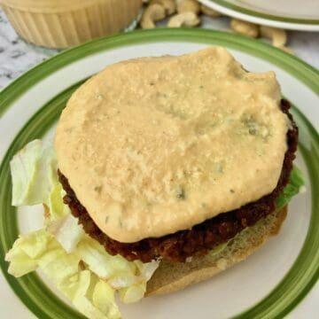 Vegan burger sauce on a burger patty.