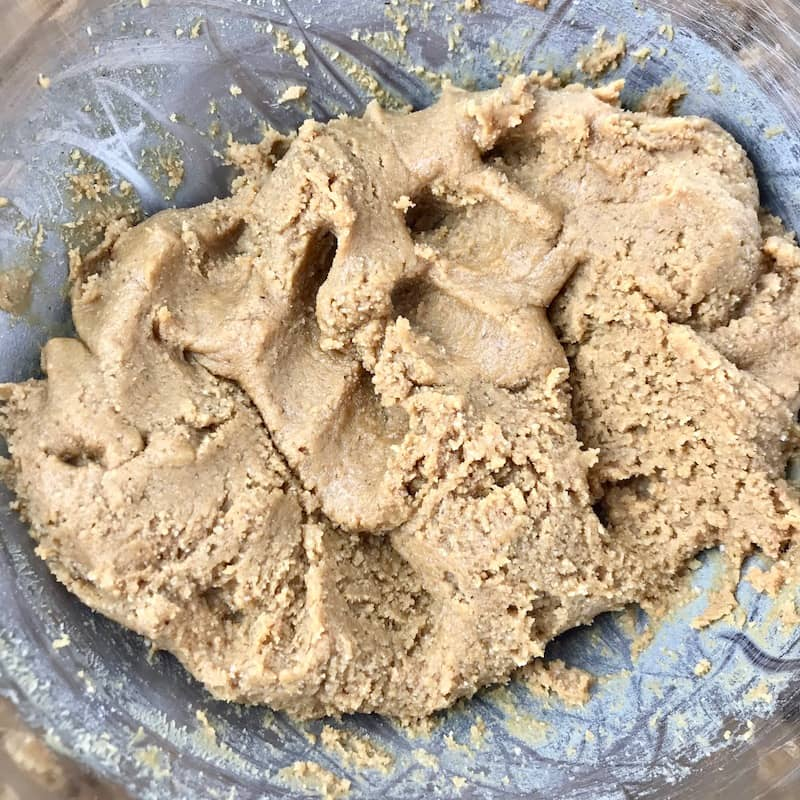 A peanut butter dough in a bowl.