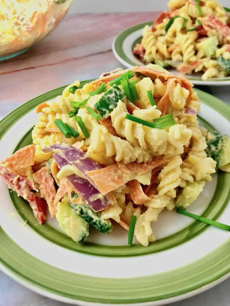 Pasta with vegetables on a plate.