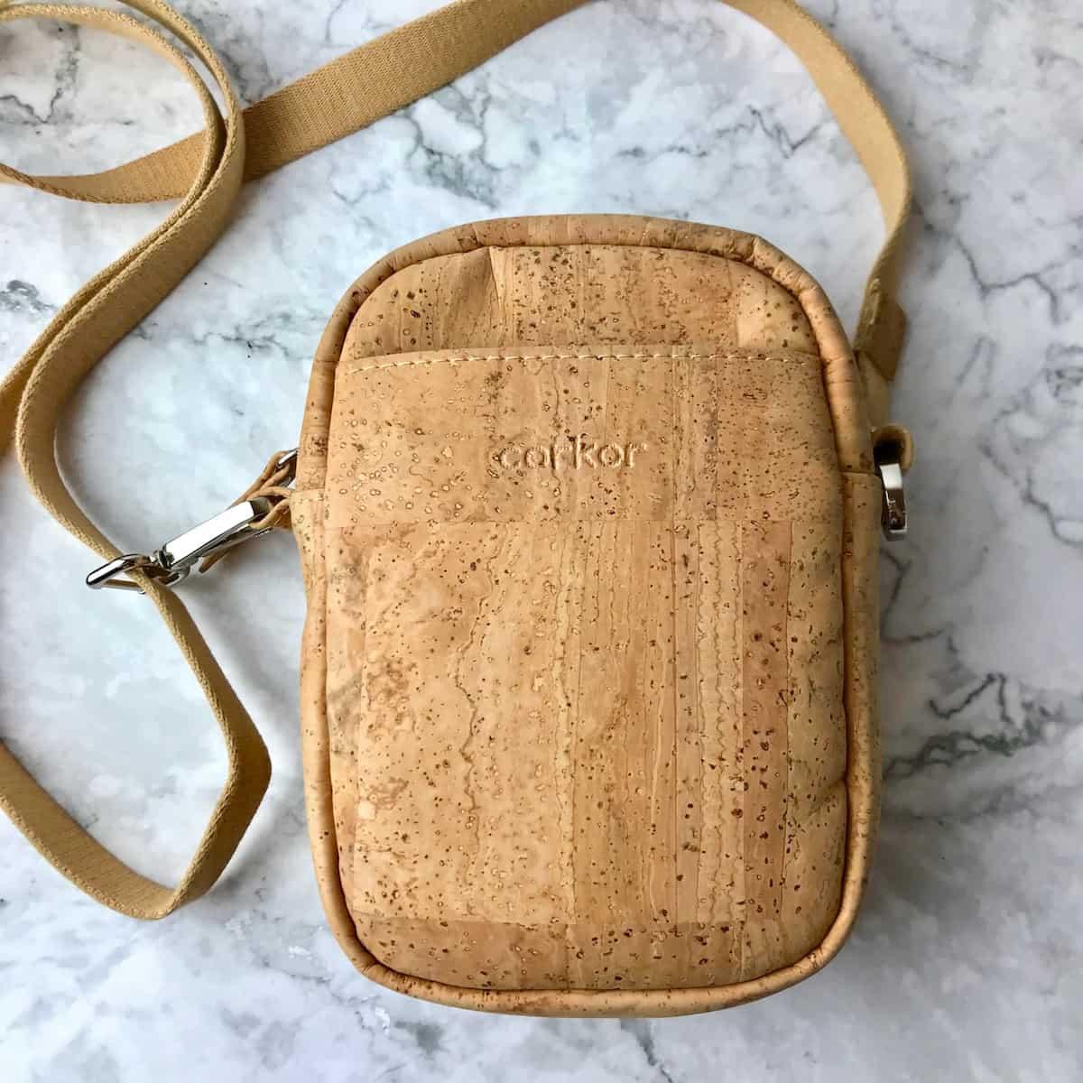 A crossbody bag made of cork.
