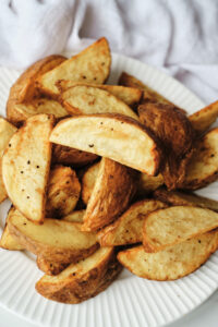 Potato wedges on a plate.