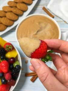 Gingerbread cheesecake dip on a strawberry.