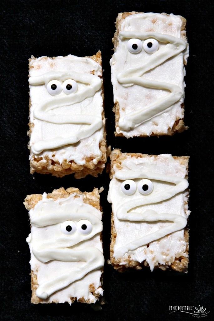 Four mummy rice krispie treats.