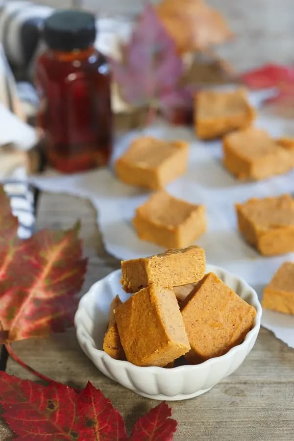 A bowl of pumpkin pie fudge, with some more in the background.