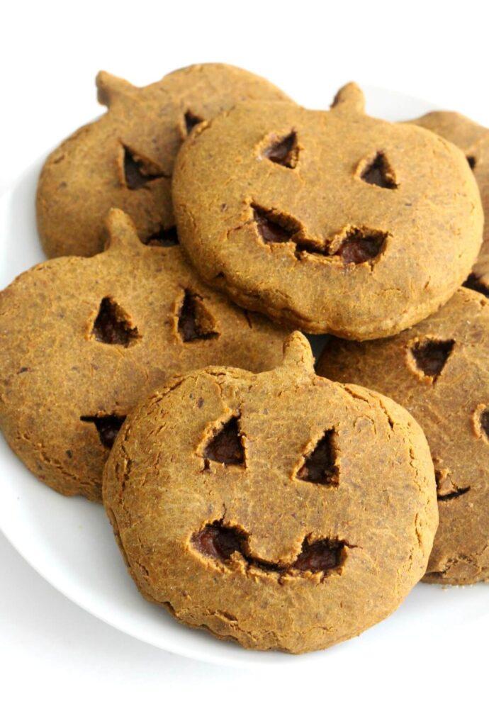 Pumpkin shaped cookies on a plate.