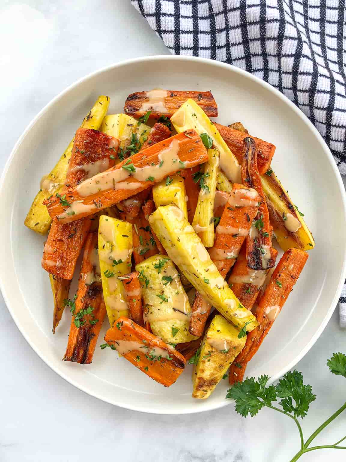 A plate of roasted carrots and pasnips.