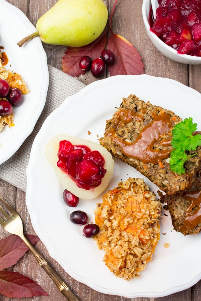 A Thanksgiving dinner plate of vegan lentil loaf, mashed sweet potatoes, and cranberry sauce.