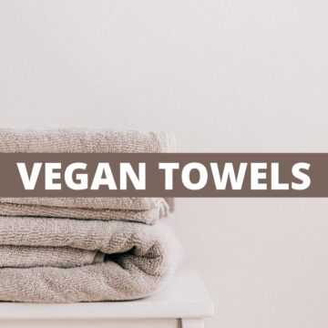 A stack of grey towels with text that says Vegan Towels.