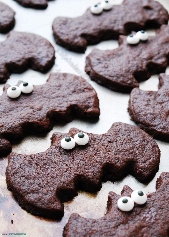 Chocolate sugar cookies in the shape of bats with candy eyes on them.